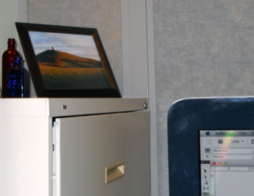 A photo of the Glastonbury Tor on the filing cabinet is a nice reminder to not let the mundane drag me down.